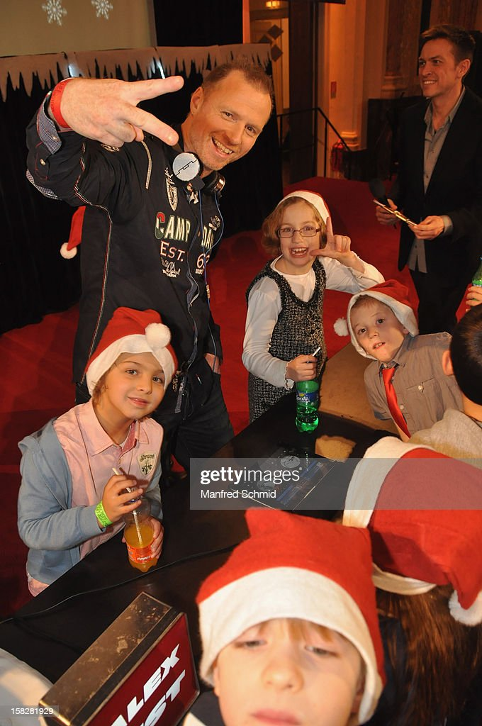 Alex List with some children attend the Christmas ball for children Energy For Life - Heat For Children's Hearts at Hofburg Vienna on December 11, 2012 in Vienna, Austria.