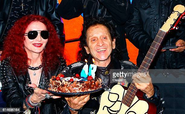 Alex Lora and his wife Chela hold a cake during the announcement of the donation of his guitar to the Hard Rock International Hotel chain at 48th...