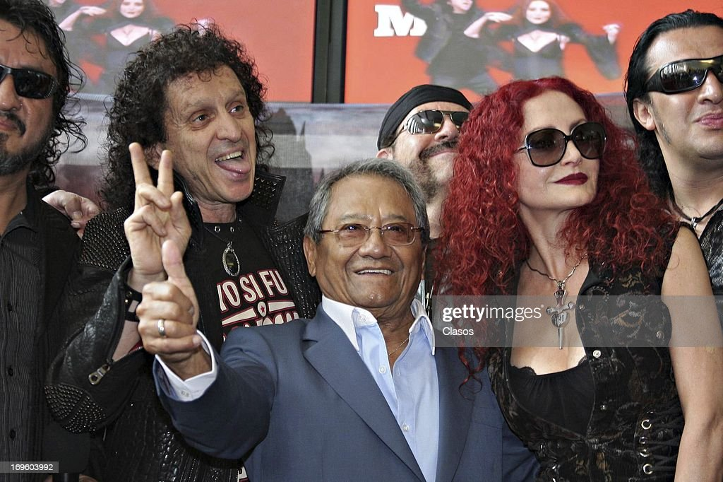 Alex Lora, El Tri and Armando Manzanero pose for a photo during the presentation of their new album called Ojo Por Ojo at the Society of Authors and Composers of Mexico on May 28, 2013 in Mexico City, Mexico.