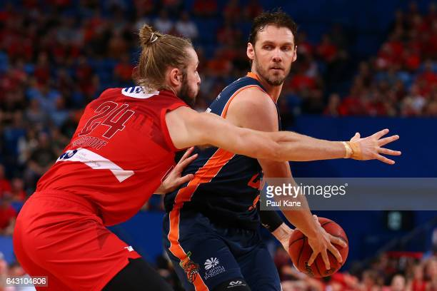 Alex Loughton of the Taipans looks to pass the ball against against Jesse Wagstaff of the Wildcats during the game two NBL Semi Final match between...