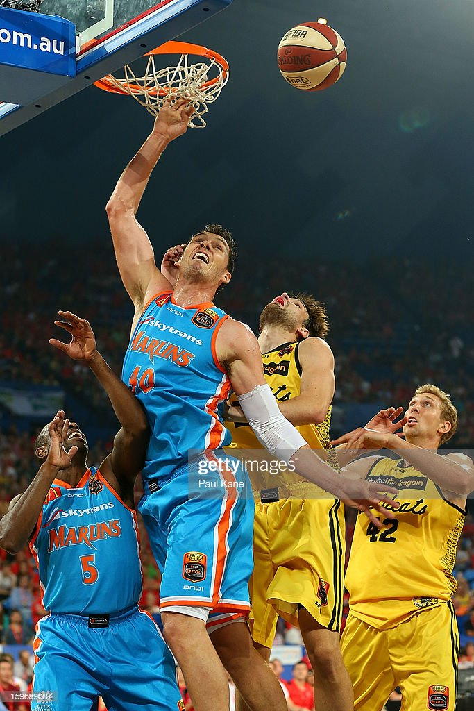 Alex Loughton of the Taipans rebounds against Jeremiah Trueman of the Wildcats during the round 15 NBL match between the Perth Wildcats and the Cairns Taipans at Perth Arena on January 18, 2013 in Perth, Australia.