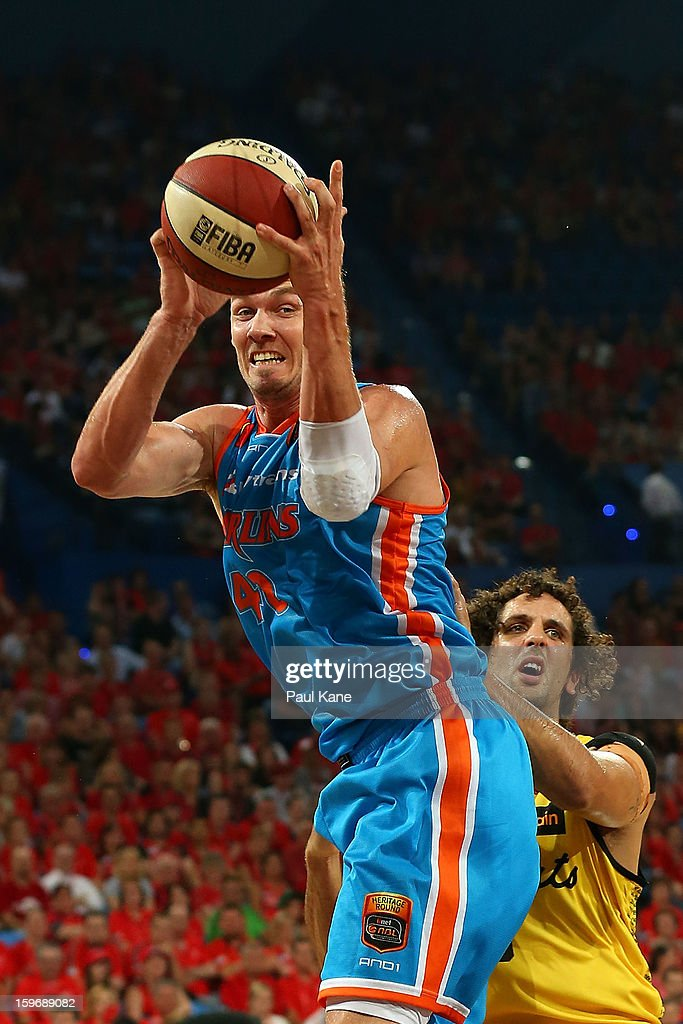 Alex Loughton of the Taipans rebounds against Matthew Knight of the Wildcats during the round 15 NBL match between the Perth Wildcats and the Cairns Taipans at Perth Arena on January 18, 2013 in Perth, Australia.