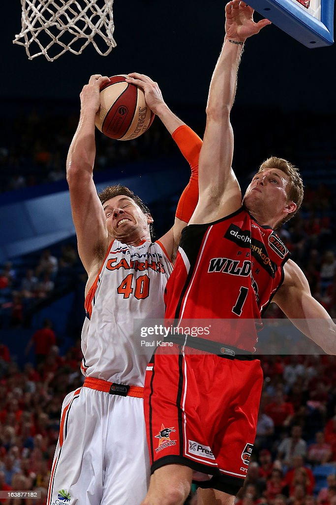Alex Loughton of the Taipans rebounds against Rhys Carter of the Wildcats during the round 23 NBL match between the Perth Wildcats and the Cairns Taipans at Perth Arena on March 17, 2013 in Perth, Australia.
