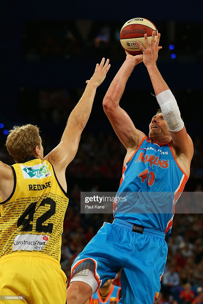 Alex Loughton of the Taipans shoots against Shawn Redhage of the Wildcats during the round 15 NBL match between the Perth Wildcats and the Cairns Taipans at Perth Arena on January 18, 2013 in Perth, Australia.