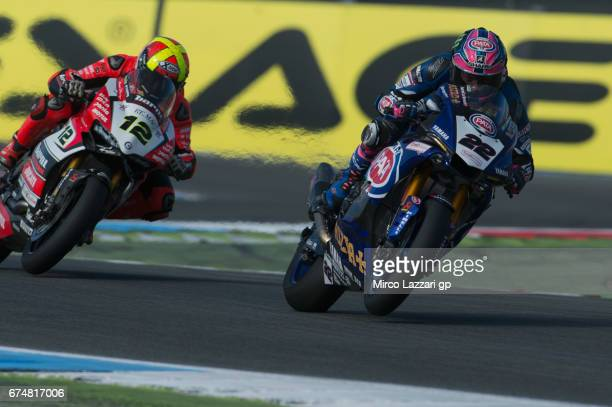 Alex Lowes of Great Britain and PATA Yamaha Official WorldSBK Team leads Xavi Fores of Spain and Barni Racing Team during the FIM World Superbike...