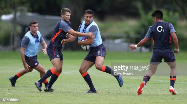 Alex Lozowski is tackled by Richard Wigglesworth during the England training session at the Lensbury Club on August 7 2017 in Teddington England