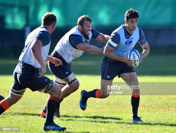 Alex Lozowski of England is tackled by Chris Robshaw of England during a training session at San Isidro Club on June 14 2017 in Buenos Aires Distrito...