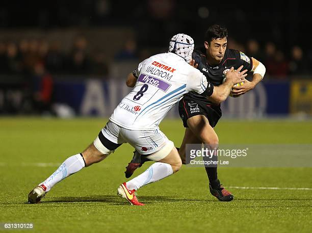 Alex Lozowski of Saracens holds off Thomas Waldrom of Exeter Chiefs during the Aviva Premiership match between Saracens and Exeter Chiefs at Allianz...