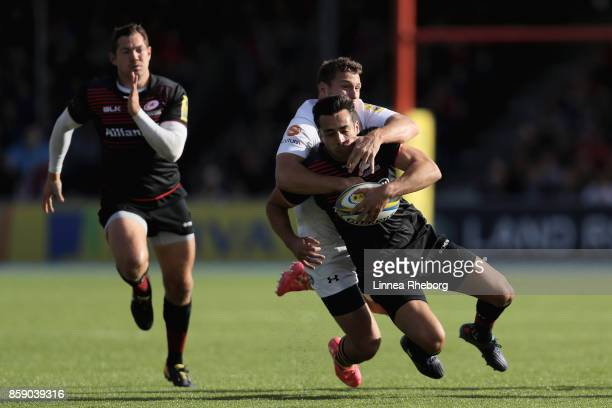 Alex Lozowski of Saracens is tackled by Elliot Daly of Wasps during the Aviva Premiership match between Saracens and Wasps at Allianz Park on October...