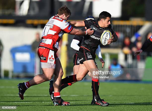 Alex Lozowski of Saracens is tackled by Paddy McAllister of Gloucester Rugby during the Aviva Premiership match between Saracens and Gloucester Rugby...