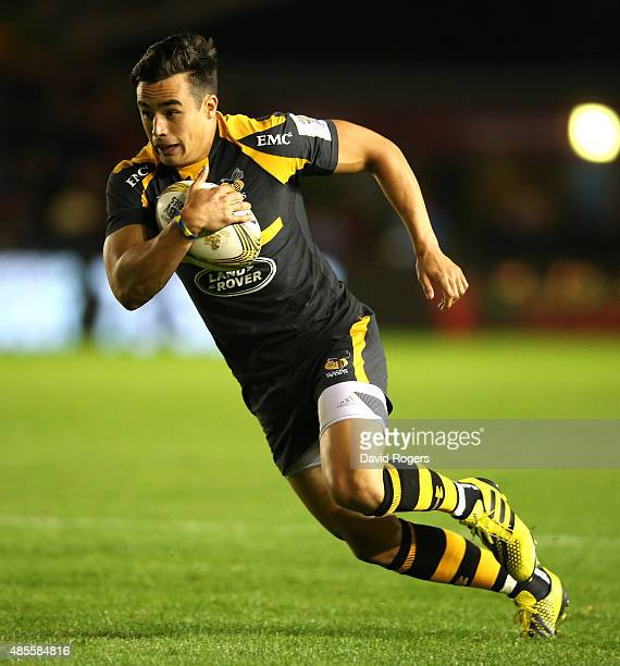 Alex Lozowski of Wasps breaks clear to score a try against Scarlets during the Singha Premiership Rugby 7's Series finals at Twickenham Stoop on...
