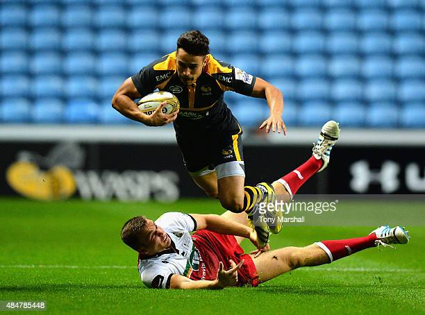 Alex Lozowski of Wasps is tackled by Tim Cardall of Northampton Saints during the Singha Premiership Rugby 7s Series Coventry at Ricoh Arena on...