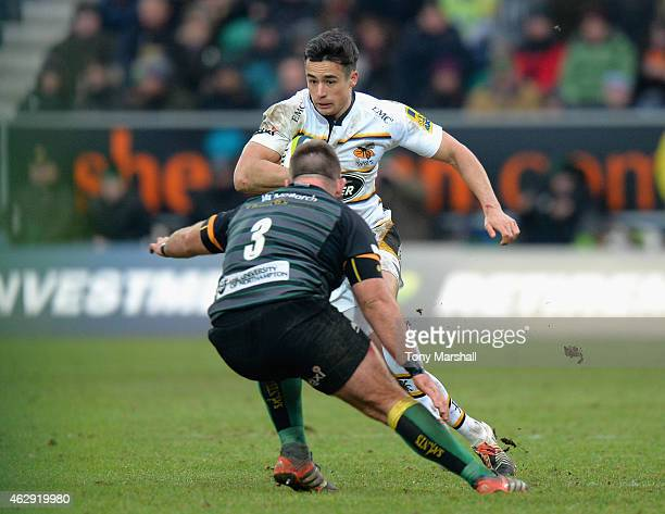 Alex Lozowski of Wasps looks for a way past Gareth Denman of Northampton Saints during the LV= Cup match between Northampton Saints and Wasps at...