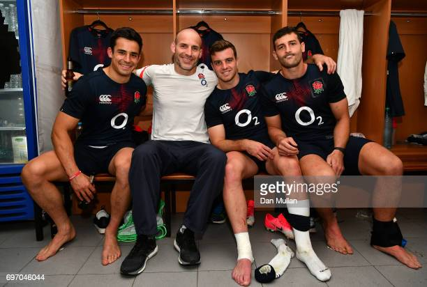 Alex Lozowski Paul Gustard Defence Coach of England George Ford and Jonny May of England celebrate following their victory during the ICBC Cup match...
