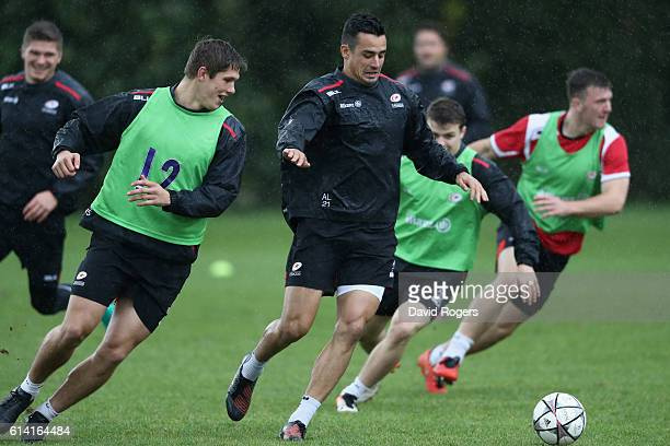 Alex Lozowski runs with the soccer ball during the Saracens training session held at their training venue on October 12 2016 in St Albans England