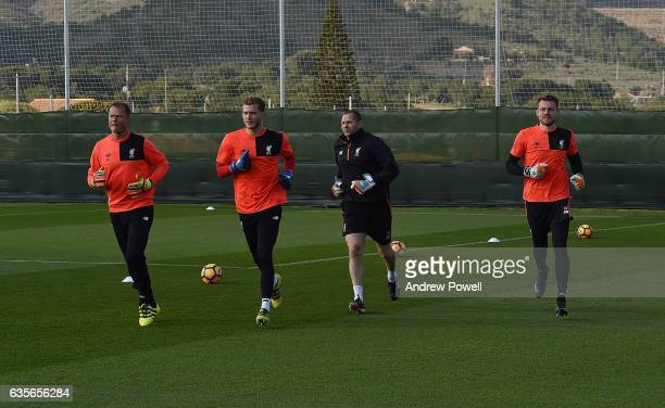 Alex Manninger Loris Karius Simon Mignolet of Liverpool and John Achterberg Firstteam goalkeeping coach of Liverpool during a training session at La...
