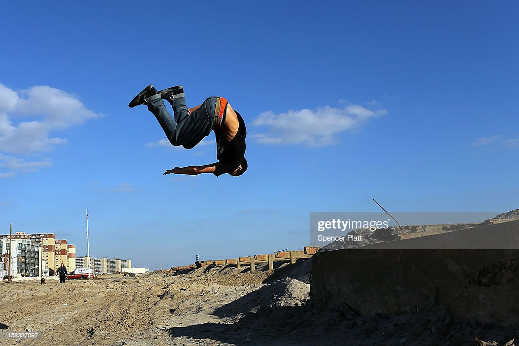 Alex Marin practices 'parkour', a sport that embraces the urban landscape as an obstacle course, on the remains of the boardwalk at Rockaway beach on December 13, 2012 in New York City. Much of the Rockaway neighborhood is still suffering the effects of Hurricane Sandy which caused extensive damage to parts of New York, New Jersey and Connecticut. Thousands of Rockaway residents and business owners are still unable to return to their properties while electricity remains sporadic in many neighborhoods.