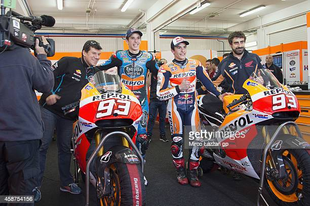 Alex Marquez and Marc Marquez of Spain and Repsol Honda Team pose in box during the MotoGP Tests in Valencia at Ricardo Tormo Circuit on November 10...
