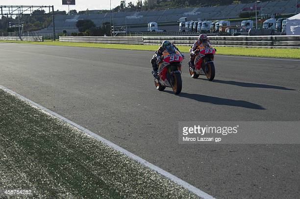 Alex Marquez leads Marc Marquez of Spain and Repsol Honda Team during the MotoGP Tests in Valencia at Ricardo Tormo Circuit on November 10 2014 in...