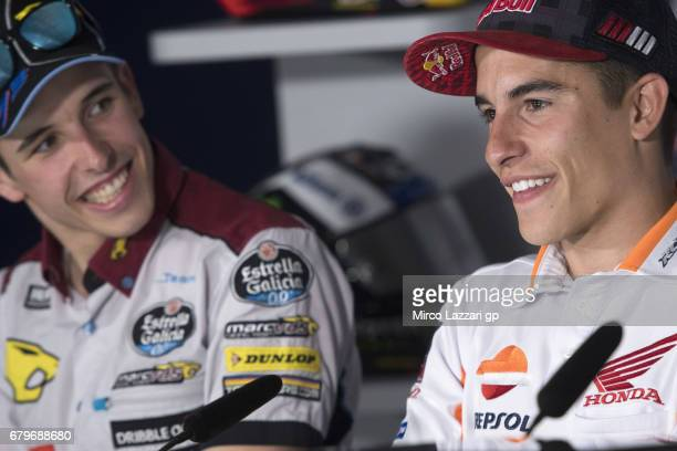 Alex Marquez of Spain and EG 00 Marc VDS and Marc Marquez of Spain and Repsol Honda Team smile during the press conference during the MotoGp of Spain...