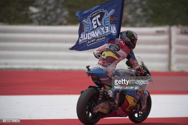 Alex Marquez of Spain and EG 00 Marc VDS celebrates the second place with the flag at the end of the Moto2 race during the MotoGp of Austria Race at...