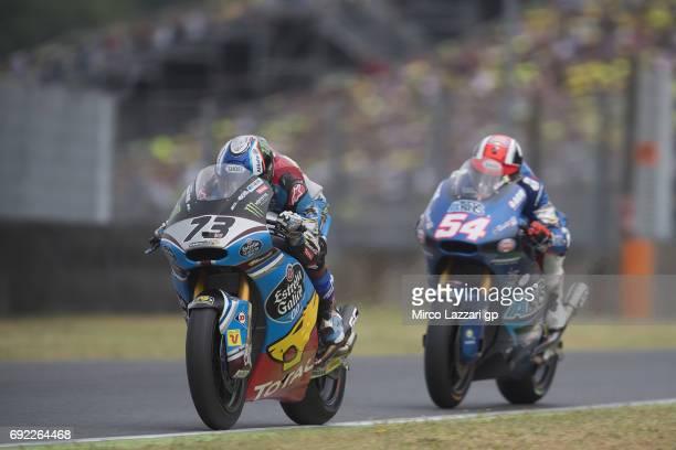 Alex Marquez of Spain and EG 00 Marc VDS leads Mattia Pasini of Italy and Italtrans Racing Team during the Moto2 race during the MotoGp of Italy Race...
