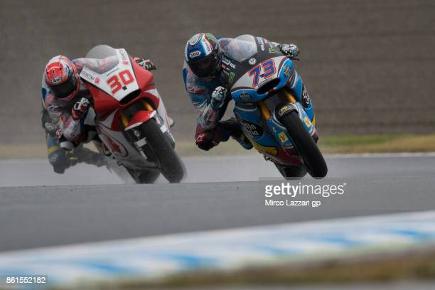 Alex Marquez of Spain and EG 00 Marc VDS leads Takaaki Nakagami of Japan and Idemitsu Honda Team Asia during the Moto2 race during the MotoGP of...