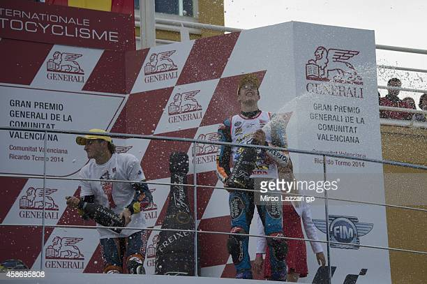 Alex Marquez of Spain and Estrella Galicia 00 and Jack Miller of Australia and Red Bull KTM Ajo celebrate on the podium at the end of the Moto3 race...
