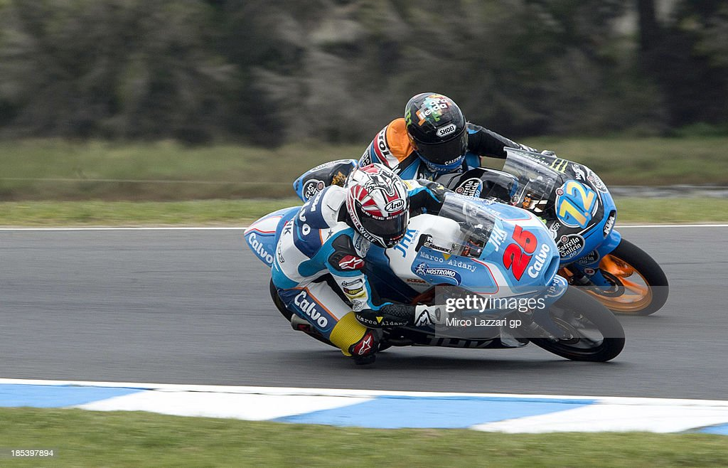 Alex Marquez (number 12) of Spain and Estrella Galicia 0'0 and Maverick Vinales of Spain and Team Calvo round the bend during the Moto3 race ahead of the Australian MotoGP, which is round 16 of the MotoGP World Championship at Phillip Island Grand Prix Circuit on October 20, 2013 in Phillip Island, Australia.