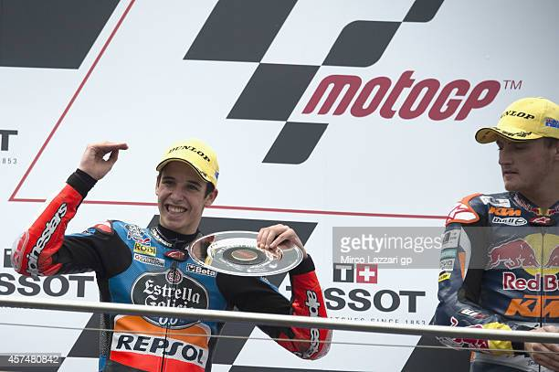 Alex Marquez of Spain and Estrella Galicia 00 celebrates on the podium the second place at the end of the Moto3 race during the 2014 MotoGP of...