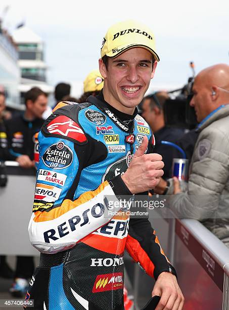 Alex Marquez of Spain and rider of the Estella Galica OO Honda celebrates after taking pole position in the Moto3 qualifying session for the 2014...