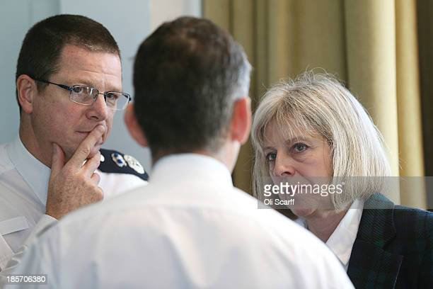 Alex Marshall the Chief Executive of The College of Policing and Home Secretary Theresa May speak with police officers after Ms May addressed The...
