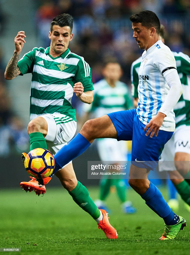 Alex Martinez of Real Betis Balompie (L) competes for the ball with Pablo Fornals (R) during La Liga match between Malaga CF and Real Betis Balompie at La Rosaleda Stadium February 28, 2017 in Malaga, Spain.