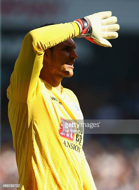 Alex McCarthy iof Crystal Palace shields his eyes during the Barclays Premier League match between Tottenham Hotspur and Crystal Palace at White Hart...