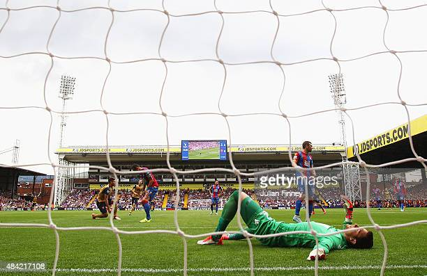 Alex McCarthy of Crystal Palace reacts after the goal scored by Olivier Giroud of Arsenal during the Barclays Premier League match between Crystal...