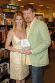 Alex McCord and Simon van Kempen from the cast of 'Real Housewives of New York City' sign copies of 'Little Kids Big City' on April 23 2010 in Boca...