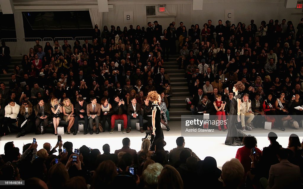 Alex McCord (4th L), Ramona Singer (5th L), Tom Murro (6th L), Countess LuAnn De Lesseps (8th L), Maksim Chmerkovskiy (9th L) and Valentin Chmerkovskiy (10th L) attend the Zang Toi Fall 2013 fashion show during Mercedes-Benz Fashion Week at The Stage at Lincoln Center on February 13, 2013 in New York City.
