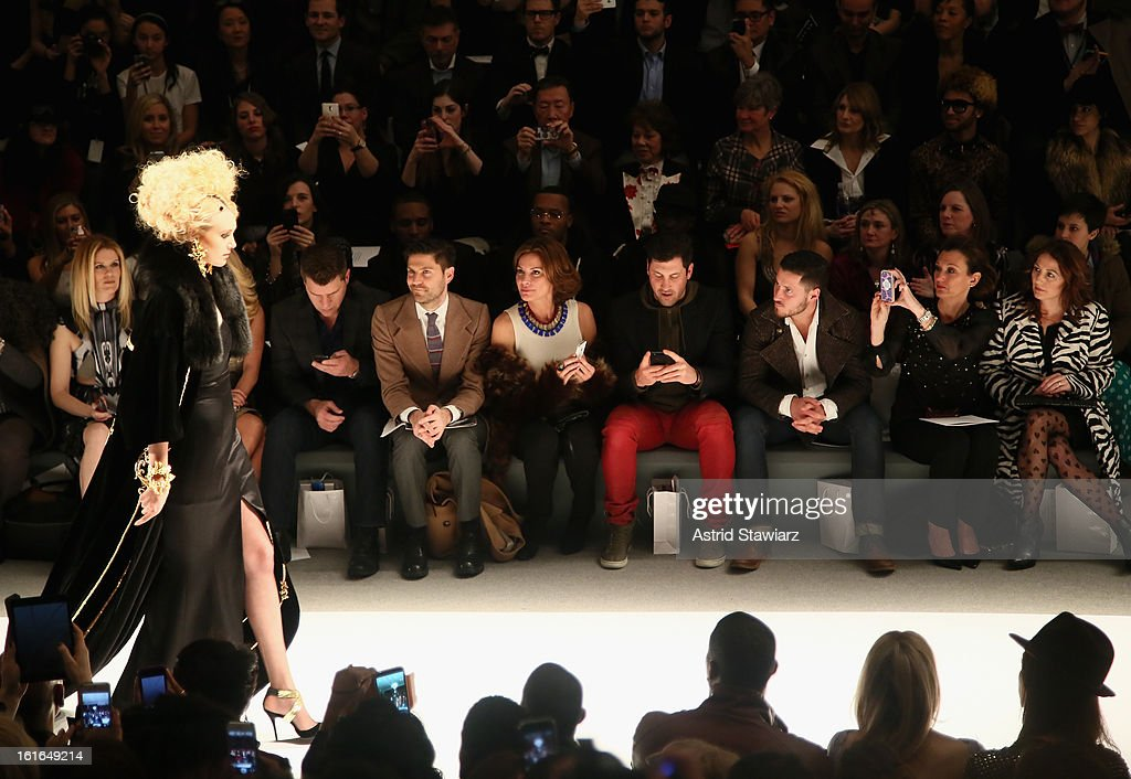 Alex McCord (L), Tom Murro (2nd L), Countess LuAnn De Lesseps (4th L), Maksim Chmerkovskiy (4th R) and Valentin Chmerkovskiy (3rd R) attend the Zang Toi Fall 2013 fashion show during Mercedes-Benz Fashion Week at The Stage at Lincoln Center on February 13, 2013 in New York City.