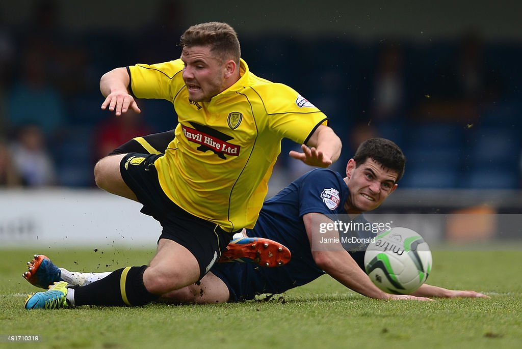 Alex McDonald of Burton Albion battles with John White of Southend United during the Sky Bet League Two semi-final, sec Keeond leg match between Southend United and Burton Albion at Roots Hall on May 17, 2014 in Southend, England.