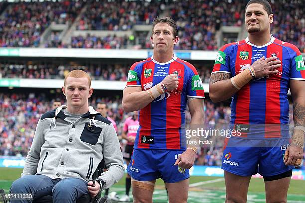 Alex McKinnon with Kurt Gidley and Willie Mason of the Knights before the game during the round 19 NRL match between the Newcastle Knights and Gold...