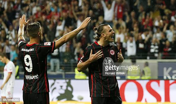 Alex Meier of Frankfurt celebrates after scoring his team's sixth goal with Haris Seferovic during the Bundesliga match between Eintracht Frankfurt...