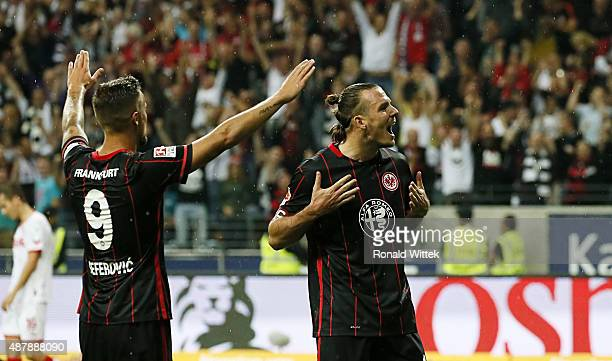 Alex Meier of Frankfurt celebrates after scoring his team's sixth goal with Haris Seferovic during the Bundesliga match between Eintracht Frankfurt...