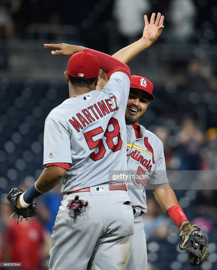 Alex Mejia #54 of the St. Louis Cardinals and Jose Martinez #58 of the celebrate after beating the San Diego Padres 8-4 in a baseball game at PETCO Park on September 5, 2017 in San Diego, California.