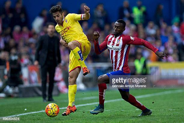 Alex Menendez of Real Sporting de Gijon competes for the ball with Jackson Arley Martinez of Atletico de Madrid during the La Liga mathc bewteen Club...