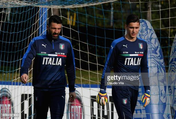 Alex Meret and Gianluigi Buffon of Italy look on during the training session at the club's training ground at Coverciano on March 22 2017 in Florence...