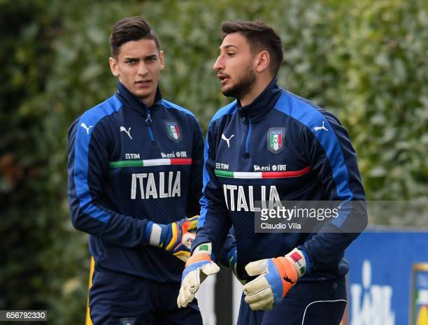 Alex Meret and Gianluigi Donnarumma of Italy chat during the training session at the club's training ground at Coverciano on March 23 2017 in...