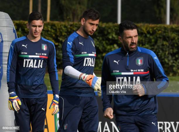 Alex Meret Gianluigi Donnarumma and Gianluigi Buffon of Italy look on during the training session at the club's training ground at Coverciano on...