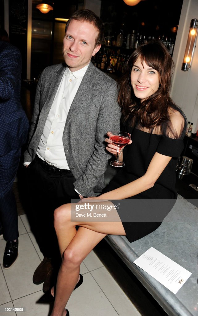 Alex Miller (L) and Alexa Chung attend as Nick Grimshaw hosts his first annual award season dinner at Hix, in association with Philips Sound, on February 19, 2013 in London, England.