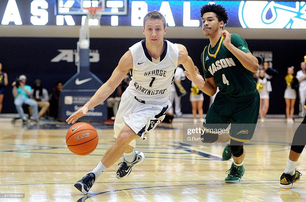 Alex Mitola of the George Washington Colonials handles the ball against the George Mason Patriots at the Charles E Smith Athletic Center on March 1...