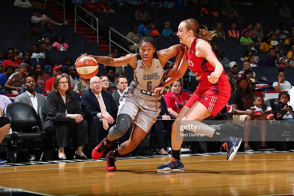 Alex Montgomery #6 of the San Antonio Stars drives to the basket against Ally Malott #11 of the Washington Mystics on June 29, 2016 at the Verizon Center in Washington, DC.